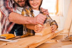 Sharing skills with his son. Stock Photography