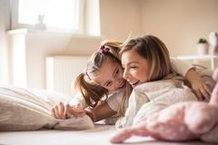 Sharing a special closeness. Mother and daughter stock photo