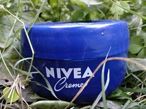 Sharing spring with Nivea. Nivea Creme in grass Royalty Free Stock Photography