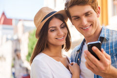 Sharing their pictures with friends. Royalty Free Stock Image