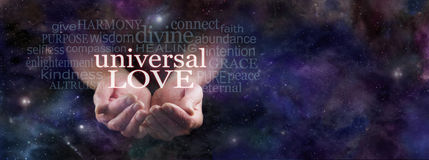 Sharing Universal Love. Man's cupped hands emerging from dark blue deep space background surrounded by a Universal Love word cloud with copy space on right hand stock photos