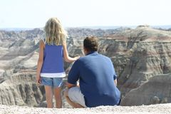 Sharing a View. A daughter and father sharing a beautiful view together Stock Image