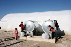 Shariya IDP camp. Water tank with children. Stock Photos
