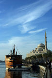 Sharjah corneiche. A Mosque and an old heritage ship in Sharjah Royalty Free Stock Image