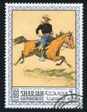 Cowboy. SHARJAH AND DEPENDENCIES - CIRCA 1972: stamp printed by Sharjah and Dependencies, shows a Painting by Frederic Remington, circa 1972 Royalty Free Stock Photo