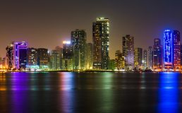 Sharjah waterfront cityscape in UAE at night stock images