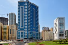 Sharjah, UAE - April 8. 2018. General view of city with residential high-rise buildings and road. Sharjah, UAE - April 8. 2018. General view of the city with Royalty Free Stock Images