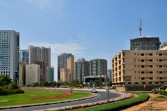 Sharjah, UAE - April 8. 2018. General view of city with residential high-rise buildings and road. Sharjah, UAE - April 8. 2018. General view of the city with Stock Photos