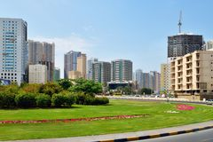 Sharjah, UAE - April 8. 2018. General view of city with residential high-rise buildings and road. Sharjah, UAE - April 8. 2018. General view of the city with Stock Photography
