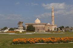 SHARJAH, UAE - DECEMBER 23, 2014: Photo of Monument on the background of the Quran Mosque. Royalty Free Stock Images