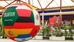 Sharjah, UAE - June, 2018: Decoration big soccer ball from flags of the world. Shopping mall, Sahara.  Stock Photography