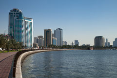Sharjah UAE. Sharjah, UAE - November 29, 2013: the main pedestrian promenade of Sharjah (Khalid Lake Train), view to the city from the North West, just next to Stock Image