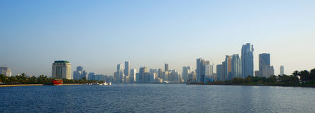 Sharjah, United Arab Emirates - April 21, 2014: view of the city at sunset with the Sharjah. Royalty Free Stock Photo