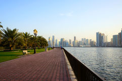 Sharjah, United Arab Emirates - April 21, 2014: view of the city at sunset with the Sharjah. Stock Photos