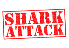 SHARK ATTACK. Red Rubber Stamp over a white background Royalty Free Stock Photo