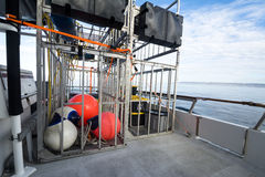 Shark cages on boat. Two shark diving cages stored on a boat during transportation to shark diving sites Stock Images