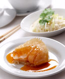 Shark fin. Serve in delicious sauce with vegetables salad side dish stock photography