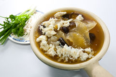 Shark Fin Soup. Delicious Shark Fin Soup topped with crab meat, Eat with beansprout and green onion Royalty Free Stock Photo