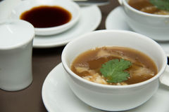 Shark Fin Soup topped with crab meat. Delicious Shark Fin Soup topped with crab meat Royalty Free Stock Photo