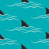 Shark fins on a blue background. Shark fins on a blue background, seamless pattern. Vector background Royalty Free Stock Photography