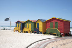 Shark lookout post flag and beach huts South Africa Stock Photo
