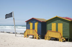Shark lookout post flag and beach huts South Africa Royalty Free Stock Image
