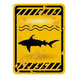 Shark sign. Grunge shark attack warning sign isolated over white Royalty Free Stock Images