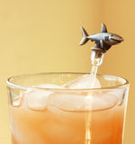 A Shark Swizzle Stick. In a Mixed Drink on the Rocks Royalty Free Stock Photo
