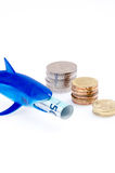 Shark toy and money Royalty Free Stock Photography