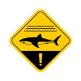 Shark warning sign with sea waves. Shark warning sign with shark side view silhouette, sea waves surface and exclamation sign. Yellow rounded square traffic royalty free illustration