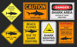 Shark warning signs. Vector illustration of different shark warning signs Royalty Free Stock Photography