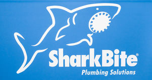 SharkBite company logo. Printed sticker letters Royalty Free Stock Photos
