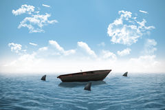 Sharks circling small boat in the ocean Royalty Free Stock Images