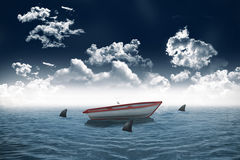 Sharks circling small boat in the sea Stock Image