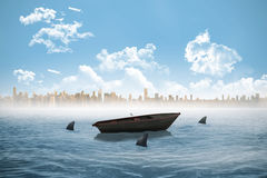 Sharks circling a small boat in the sea Royalty Free Stock Photo