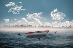 Sharks circling a small boat in the sea Stock Image