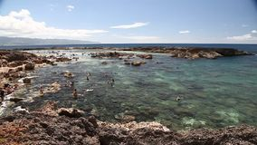 Sharks Cove snorkeling. Oahu, Hawaii - August 26, 2016:Scenic panorama of Sharks Cove, Hawaii, a small rocky bay side of Pupukea Beach Park. One of the best stock video