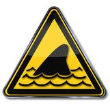 Sharks and dorsal fin. Warning sign sharks and dorsal fin Royalty Free Stock Photo