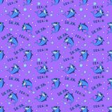Sharks silhouettes seamless pattern. Blue smiling shark on a purple background with an inscription Ocean Shark and stock photos