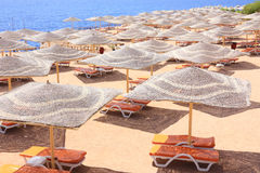 Sharm El Sheik resort beach. Umbrellas and beach bed in Sharm El Sheikh resort Stock Image