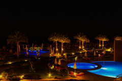 Sharm El Sheikh, Egypt - April 7, 2017: Evening view of swimming pool at luxury hotel Barcelo Tiran Sharm 5 stars at Stock Image