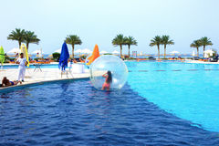Sharm El Sheikh, Egypt - April 09, 2017: The girl in an inflatable balloon, having fun on the water. Stock Photo