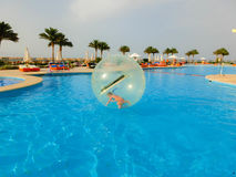 Sharm El Sheikh, Egypt - April 09, 2017: Little girl in an inflatable balloon, having fun on the water. Royalty Free Stock Image