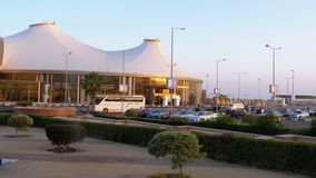View of the airport terminal in Sharm el Sheikh from the bus window. Sharm El Sheikh, Egypt, April 4, 2019: View of the airport terminal in Sharm el Sheikh from stock video