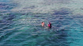 Sharm el-Sheikh, Egypt - December 6, 2016: people in life jackets and mask with a tube are beginning dive into the water. And do snorkelling in the Red Sea with stock footage
