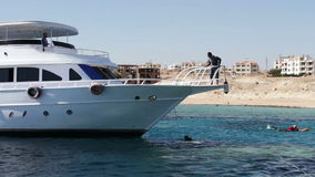 Sharm el-Sheikh, Egypt - December 6, 2016: Tourist yachts are in the Red Sea.Snorkeling and scuba divers are preparing stock footage