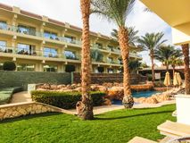 Sharm El Sheikh, Egypt - December 31, 2018: Tropical luxury Xperience Sea Breeze Resort on Red Sea beach. Swimming pool , water slide and poolside seating area royalty free stock photo