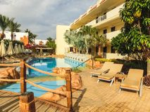 Sharm El Sheikh, Egypt - December 31, 2018: Tropical luxury Xperience Sea Breeze Resort on Red Sea beach. Swimming pool , water slide and poolside seating area royalty free stock images