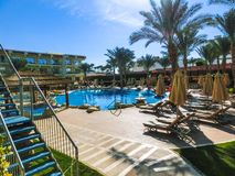 Sharm El Sheikh, Egypt - December 31, 2018: Tropical luxury Xperience Sea Breeze Resort on Red Sea beach. Swimming pool , water slide and poolside seating area stock photo