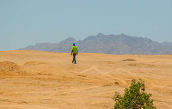 SHARM EL SHEIKH, EGYPT - JULY 9, 2009. man goes desert Stock Photo